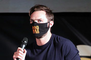 """Nicholas Hoult speaks onstage at Charlize Theron Hosts Drive-In Screening of """"Mad Max: Fury Road"""" Benefiting the Charlize Theron Africa Outreach Project at The Grove on July 31, 2020 in Los Angeles, California."""