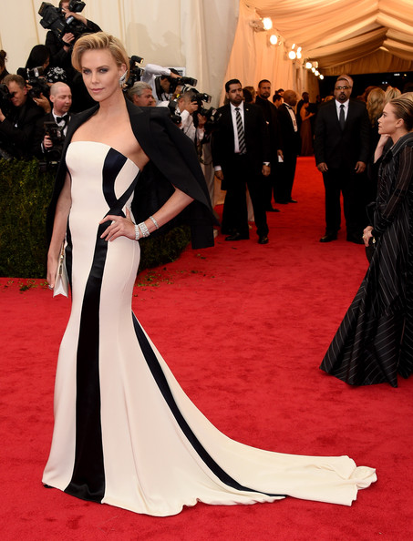 Red Carpet Arrivals at the Met Gala — Part 3 [charles james: beyond fashion costume institute gala,gown,flooring,carpet,dress,fashion model,red carpet,shoulder,lady,fashion,formal wear,red carpet arrivals,charlize theron,part,new york city,metropolitan museum of art,met gala]