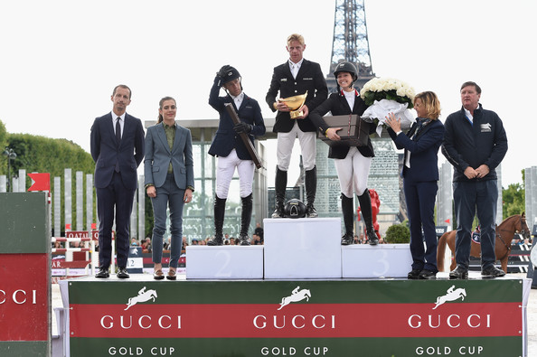 Charlotte Casiraghi Robert Triefus (L), Charlotte Casiraghi (2L), Virginie Couperie-Eiffel (2R) and Jan Tops (R) pose with the Winners of the 'Gucci Gold Cup Paris Eiffel Jumping Table A against the clock with jump-off ' Maikel van der Vleuten (2nd rank), Marcus Ehning (1st rank) and Reed Kessler (3rd rank) during the Paris Eiffel Jumping presented by Gucci at Champ-de-Mars on July 6, 2014 in Paris, France.