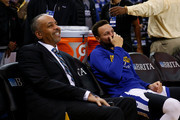 Stephen Curry #30 of the Golden State Warriors talks to his father Dell Curry before the game against the Charlotte Hornets at ORACLE Arena on December 29, 2017 in Oakland, California. NOTE TO USER: User expressly acknowledges and agrees that, by downloading and or using this photograph, User is consenting to the terms and conditions of the Getty Images License Agreement.