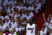 Luol Deng #9 of the Miami Heat reacts to a three pointer during Game Seven of the Eastern Conference Quarterfinals of the 2016 NBA Playoffs against the Charlotte Hornets at American Airlines Arena on May 1, 2016 in Miami, Florida. NOTE TO USER: User expressly acknowledges and agrees that, by downloading and or using this photograph, User is consenting to the terms and conditions of the Getty Images License Agreement
