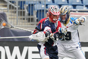 David Emala #0 of the Boston Cannons and Kevin Drew #19 of the Charlotte Hounds fight for the ball during a game between the Charlotte Hounds and the Boston Cannons April 26, 2015 at Gillette Stadium in Foxboro, Massachusetts.