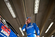 Elliott Sadler, driver of the (1) OneMain Financial Chevrolet, stands in the garage area during practice for the NASCAR XFINITY Series Drive for the Cure 200 at Charlotte Motor Speedway on September 28, 2018 in Charlotte, North Carolina.