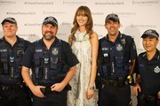 Model Nicole Pollard poses with Queensland Police during the 'Chase the Sun' Fashion Showcase at Indooroopilly Shopping Centre on September 3, 2015 in Brisbane, Australia.