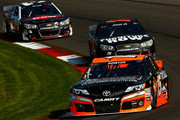 Clint Bowyer, driver of the #15 RK Motors Charlotte Toyota, leads a pack of cars during the NASCAR Sprint Cup Series Cheez-It 355 at Watkins Glen International on August 10, 2014 in Watkins Glen, New York.