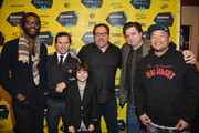 "(L-R) Musician Gary Clark, Jr, actor John Leguizamo, actor Emjay Anthony, director Jon Favreau, actor Oliver Platt and chef Roy Choi pose for photos in the Green Room for the premiere of ""Chef"" during the 2014 SXSW Music, Film + Interactive Festival at the Paramount Theatre on March 7, 2014 in Austin, Texas."