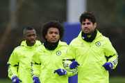 Ramires, Willian and Diego Costa of Chelsea warm up during a Chelsea training session ahead of the UEFA Champions League round of 16 match against Paris Saint-Germain at Cobham Training Centre on February 16, 2015 in London, United Kingdom.