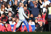 A member of the backroom staff at Chelsea celebrates his sides second goal infront of Jose Mourinho, Manager of Manchester Unied during the Premier League match between Chelsea FC and Manchester United at Stamford Bridge on October 20, 2018 in London, United Kingdom.