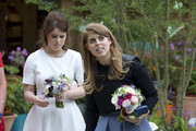 Princess Eugenie and Princess Beatrice in the RHS Greening Grey Britain Garden by Anne-Marie Powell attend the Chelsea Flower Show press day at Royal Hospital Chelsea on May 23, 2016 in London, England. The show, which has run annually since 1913 in the grounds of the Royal Hospital Chelsea, is open to the public from 24-28 May.