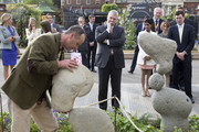 Prince Andrew, Duke of York (C) and Jack Brooksbank (R) visit Adrian Gray Stonebalancing's stand as he attends the Chelsea Flower Show press day at Royal Hospital Chelsea on May 23, 2016 in London, England. The show, which has run annually since 1913 in the grounds of the Royal Hospital Chelsea, is open to the public from 24-28 May.