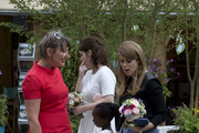 Princess Eugenie and Princess Beatrice in the RHS Greening Grey Britain Garden by Anne-Marie Powell as they attend the Chelsea Flower Show press day at Royal Hospital Chelsea on May 23, 2016 in London, England. The show, which has run annually since 1913 in the grounds of the Royal Hospital Chelsea, is open to the public from 24-28 May.