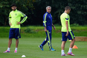 Diego Costa and manager Jose Mourinho of Chelsea look on during a Chelsea training session at the Chelsea training ground on September 16, 2014 in Cobham, United Kingdom.