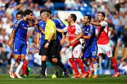 Referee Mike Dean talks with Sesc Fabregas of Chelsea during the Barclays Premier League match between Chelsea and Arsenal at Stamford Bridge on September 19, 2015 in London, United Kingdom.
