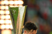 Mesut Ozil of Arsenal removes his runners up medal following his team's defeat in the UEFA Europa League Final between Chelsea and Arsenal at Baku Olimpiya Stadionu on May 29, 2019 in Baku, Azerbaijan.