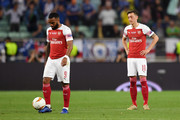 Mesut Ozil of Arsenal and Alexandre Lacazette of Arsenal react to Chelsea scoring their first goal during the UEFA Europa League Final between Chelsea and Arsenal at Baku Olimpiya Stadionu on May 29, 2019 in Baku, Azerbaijan.