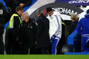 Diego Costa of Chelsea walks past Jose Mourinho Manager of Chelsea toward the bench prior to the Barclays Premier League match between Chelsea and A.F.C. Bournemouth at Stamford Bridge on December 5, 2015 in London, England.