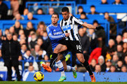 (L-R) Eden Hazard of Chelsea and Hatem Ben Arfa of Newcastle United challenge for the ball during the Barclays Premier League match between Cheslea and Newcastle United at Stamford Bridge on February 8, 2014 in London, England.