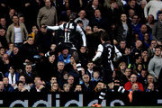 Papiss Cisse of Newcastle celebrates after scoring the opening goal with teammate Davide Santon (R) during the Barclays Premier League match between Chelsea and Newcastle United at Stamford Bridge on May 2, 2012 in London, England.