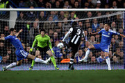 Papiss Cisse of Newcastle scores the opening goal despite the efforts from Branislav Ivanovic (L) and John Terry of Chelsea during the Barclays Premier League match between Chelsea and Newcastle United at Stamford Bridge on May 2, 2012 in London, England.