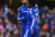 Diego Costa of Chelsea (L) celebrates with Willian as he scores thei first goal during the Emirates FA Cup third round match between Chelsea and Scunthorpe United at Stamford Bridge on January 10, 2016 in London, England.