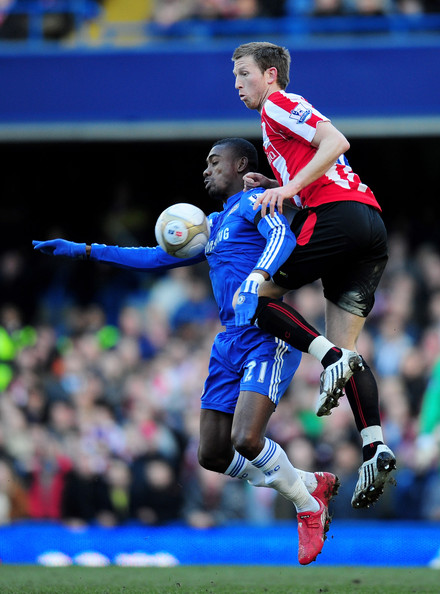 Kalou Danny Collins of Stoke City challenges Salomon Kalou of Chelsea