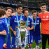 Diego Costa Photos - (L-R) Filipe Luis, Diego Costa, Cesc Fabregas, Cesar Azpilicueta and Thibaut Courtois of Chelsea celebrate with the trophy after the Barclays Premier League match between Chelsea and Sunderland at Stamford Bridge on May 24, 2015 in London, England. Chelsea were crowned Premier League champions. - Chelsea v Sunderland - Premier League