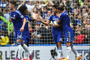 Diego Costa (2nd R) of Chelsea celebrates scoring his team's first goal from the penalty spot with his team mates Branislav Ivanovic (1st R) Gary Cahill (1st L) and Willian (2nd L) during the Barclays Premier League match between Chelsea and Sunderland at Stamford Bridge on May 24, 2015 in London, England.