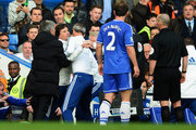 Chelsea coach Rui Faria is held back by Jose Mourinho and other members of coaching staff as he confronts match referee Mike Dean during the Barclays Premier League match between Chelsea and Sunderland at Stamford Bridge on April 19, 2014 in London, England.