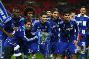 Ramires, Oscar, Filipe Luis, Willian and Diego Costa of Chelsea pose with the trophy during the Capital One Cup Final match between Chelsea and Tottenham Hotspur at Wembley Stadium on March 1, 2015 in London, England.