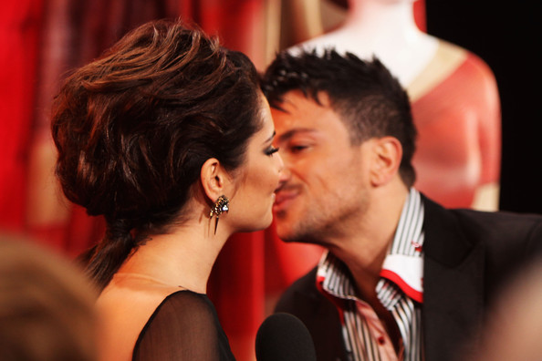 Cheryl Cole (UK TABLOID NEWSPAPERS OUT) Cheryl Cole is greeted by Peter Andre as she attends The Brit Awards 2011 held at The O2 Arena on February 15, 2011 in London, England.