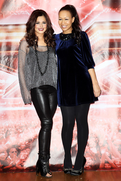 Cheryl Cole (UK TABLOID NEWSPAPERS OUT) L-R Cheryl Cole and Rebecca Ferguson pose for a photocall to promote the X-Factor final held at The Connaught Hotel on December 9, 2010 in London, England.