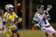 Joe Walters #1 of the Chesapeake Bayhawks is defended by Roman Lao-Gosney #19 of the Florida Launch  during a game at FAU Stadium on June 28, 2014 in Boca Raton, Florida.