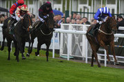 Paul Hanagan riding Mukhmal (R) win The Manor House Stables Lily Agnes Conditions Stakes at Chester racecourse on May 07, 2014 in Chester, England.