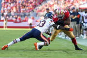 Running back Carlos Hyde #28 of the San Francisco 49ers gets hit by cornerback Charles Tillman #33 of the Chicago Bears during the second quarter of their game at Levi's Stadium on September 14, 2014 in Santa Clara, California.