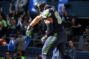 Tight end Jimmy Graham #88 of the Seattle Seahawks celebrates after scoring a touchdown in the third quarter of the game against the Chicago Bears at CenturyLink Field on September 27, 2015 in Seattle, Washington.