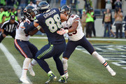 Tight end Jimmy Graham #88 of the Seattle Seahawks drags safety Adrian Amos #8 and cornerback Kyle Fuller #23 of the Chicago Bears as he scores a touchdown in the third quarter of the game against the Chicago Bears at CenturyLink Field on September 27, 2015 in Seattle, Washington.