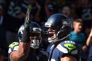 Tight end Jimmy Graham #88 of the Seattle Seahawks celebrates with running back Fred Jackson #22 of the Seattle Seahawks after scoring a touchdown in the third quarter of the game against the Chicago Bears at CenturyLink Field on September 27, 2015 in Seattle, Washington.