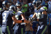 Tight end Jimmy Graham #88 of the Seattle Seahawks celebrates with quarterback Russell Wilson #3 of the Seattle Seahawks after scoring a touchdown in the third quarter of the game against the Chicago Bears at CenturyLink Field on September 27, 2015 in Seattle, Washington.