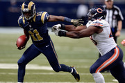 Tavon Austin #11 of the St. Louis Rams carries the ball as he fends off Eddie Royal #19 of the Chicago Bears in the third quarter at the Edward Jones Dome on November 15, 2015 in St. Louis, Missouri.