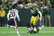 Jimmy Graham #80 of the Green Bay Packers is tackled by Eddie Jackson #39 of the Chicago Bears during the second quarter of a game at Lambeau Field on September 9, 2018 in Green Bay, Wisconsin.