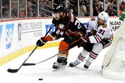 Simon Despres #24 of the Anaheim Ducks and Brad Richards #91 of the Chicago Blackhawks go after the puck in the second period in Game Seven of the Western Conference Finals during the 2015 NHL Stanley Cup Playoffs  at the Honda Center on May 30, 2015 in Anaheim, California.