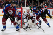 Jonathan Toews #19 of the Chicago Blackhawks controls the puck against Jan Hejda #8, goalie Calvin Pickard #31 and Brad Stuart #17 of the Colorado Avalanche at Pepsi Center on December 27, 2014 in Denver, Colorado. The Blackhawks defeated the Avalanche 5-2.