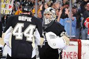 Brooks Orpik #44 of the Pittsburgh Penguins congratulates goaltender Marc-Andre Fleury #29 of the Pittsburgh Penguins after Pittsburgh defeated the Chicago Blackhawks 3-2 on December 20, 2011 at CONSOL Energy Center in Pittsburgh, Pennsylvania.