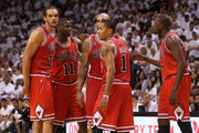 (L-R) Joakim Noah #13, Ronnie Brewer #11, Carlos Boozer #5, Derrick Rose #1 and Luol Deng #9 of the Chicago Bulls look on against the Miami Heat in Game Four of the Eastern Conference Finals during the 2011 NBA Playoffs on May 24, 2011 at American Airlines Arena in Miami, Florida. The Heat won 101-93 in overtime. NOTE TO USER: User expressly acknowledges and agrees that, by downloading and or using this photograph, User is consenting to the terms and conditions of the Getty Images License Agreement.