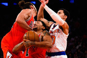 Derrick Rose #1 of the Chicago Bulls is fouled while attempting to dribble between teammate Joakim Noah #13 and Shane Larkin #0 of the New York Knicks in the second quarter during a game at Madison Square Garden on October 29, 2014 in New York City. NOTE TO USER: User expressly acknowledges and agrees that, by downloading and/or using this photograph, user is consenting to the terms and conditions of the Getty Images License Agreement.