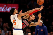 Denzel Valentine #45 of the Chicago Bulls passes the ball as Courtney Lee #5 of the New York Knicks defends at Madison Square Garden on January 10, 2018 in New York City.The Chicago Bulls defeated the New York Knicks 122-119 in double overtime. NOTE TO USER: User expressly acknowledges and agrees that, by downloading and or using this Photograph, user is consenting to the terms and conditions of the Getty Images License Agreement