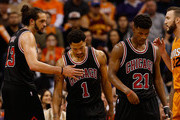 Joakim Noah #13, Derrick Rose #1 and Jimmy Butler #21 of the Chicago Bulls react during the second half of the NBA game against the Phoenix Suns at US Airways Center on January 30, 2015 in Phoenix, Arizona. The Suns defeated the Bulls 99-93. NOTE TO USER: User expressly acknowledges and agrees that, by downloading and or using this photograph, User is consenting to the terms and conditions of the Getty Images License Agreement.