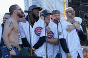 """(L-R) Travis Wood, Dexter Fowler, Anthony Rizzo, Jon Lester and David Ross of the Chicago Cubs sing """"Go, Cubs, Go"""" during the Chicago Cubs victory celebration in Grant Park on November 4, 2016 in Chicago, Illinois. The Cubs won their first World Series championship in 108 years after defeating the Cleveland Indians 8-7 in Game 7."""