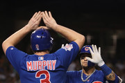 Javier Baez #9 of the Chicago Cubs high fives Daniel Murphy #3 after hiting a two-run home run against the Arizona Diamondbacks during the first inning of the MLB game at Chase Field on September 18, 2018 in Phoenix, Arizona.
