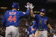 Daniel Murphy #3 of the Chicago Cubs high fives Anthony Rizzo #44 after hitting a two-run home run against the Arizona Diamondbacks during the second inning of the MLB game at Chase Field on September 18, 2018 in Phoenix, Arizona.